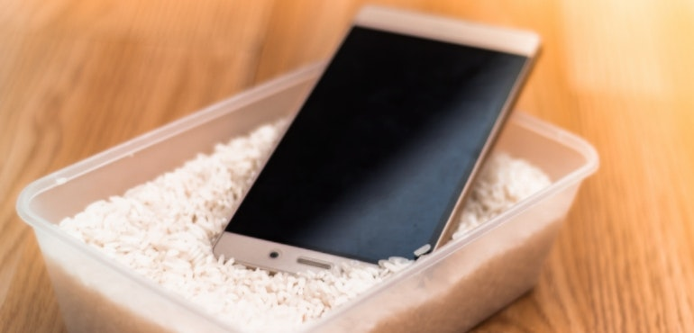 Water-damaged smartphone in rice